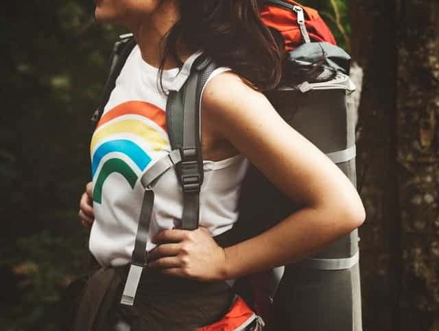 a woman with a hiking backpack