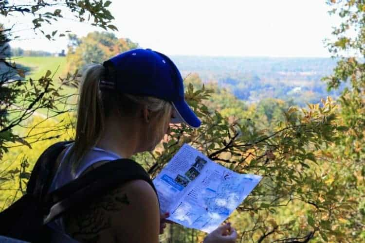 woman reading a map during a hike