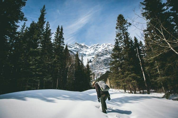 a hiker walking in the snow
