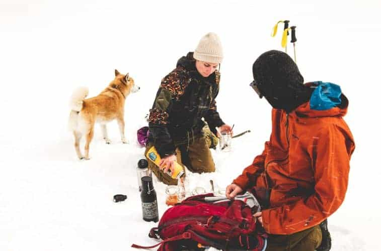 a couple eating in the snow