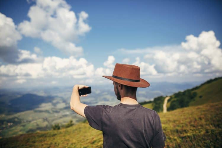 man taking selfie in the mountains