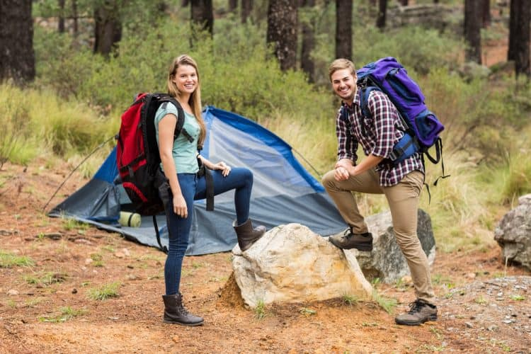 couple camping and hiking