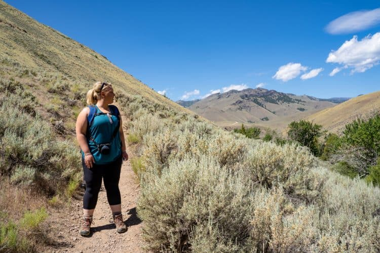 an overweight woman hiking