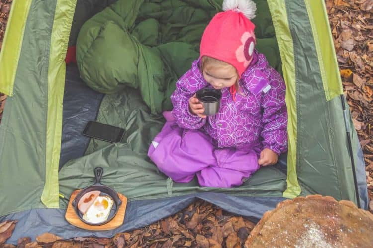 kid eating a breakfast in the outdoors