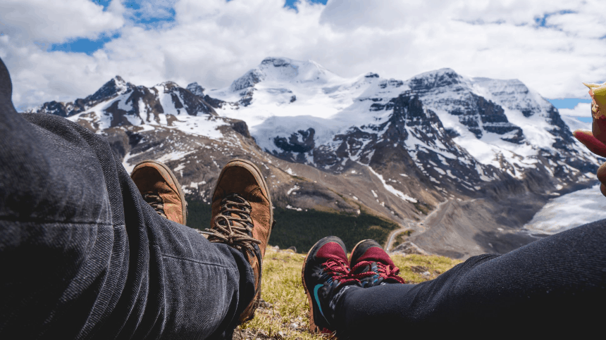hiking boots on a mountain background