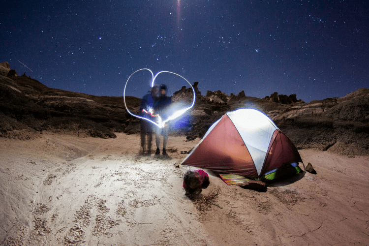 a couple camping with a tent