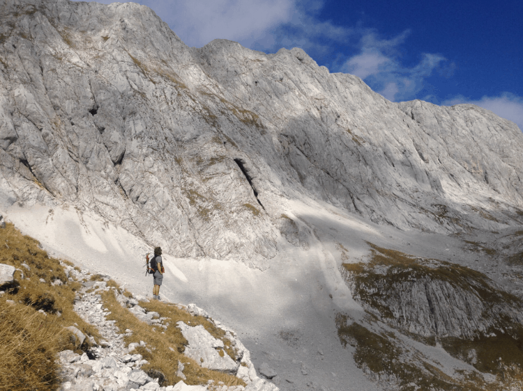a woman hiking in the snowy mountains