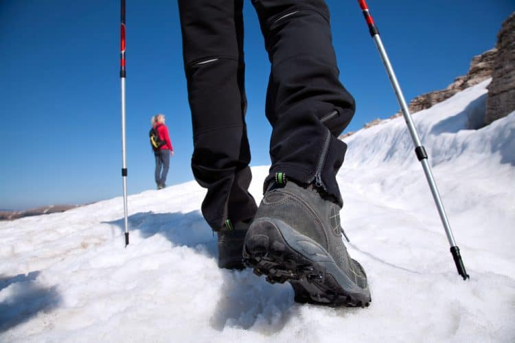 hiking boots on the snow mountain trail