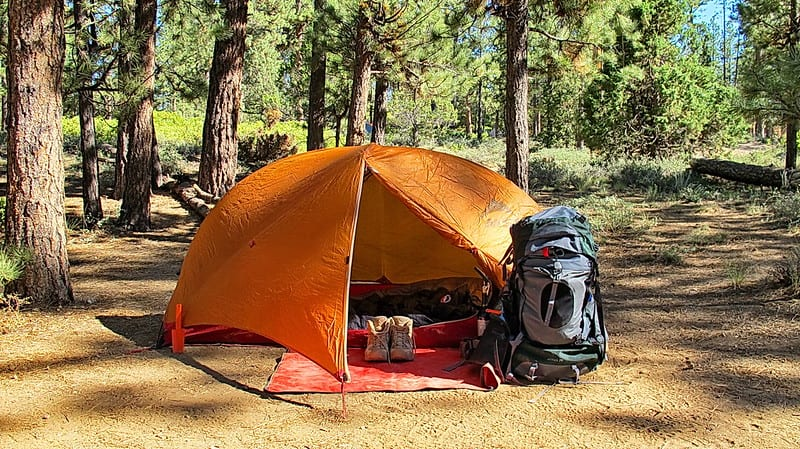 sleeping pad and a tent