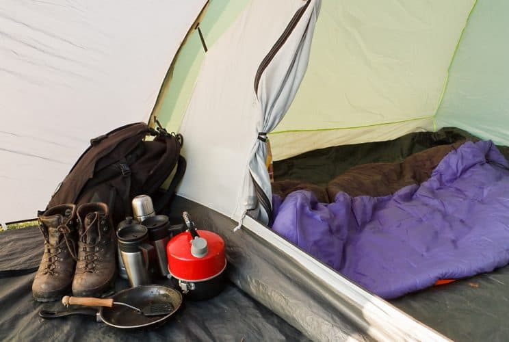 a camping tent with hiking gear inside