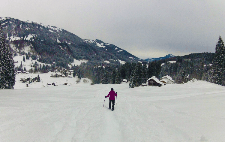 man backpacking in winter