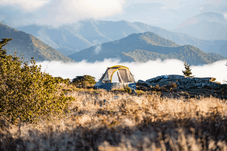a wet tent pitched in the mountains