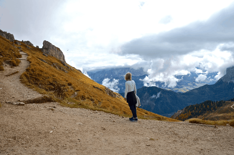 a woman looking at a stunning mountain view