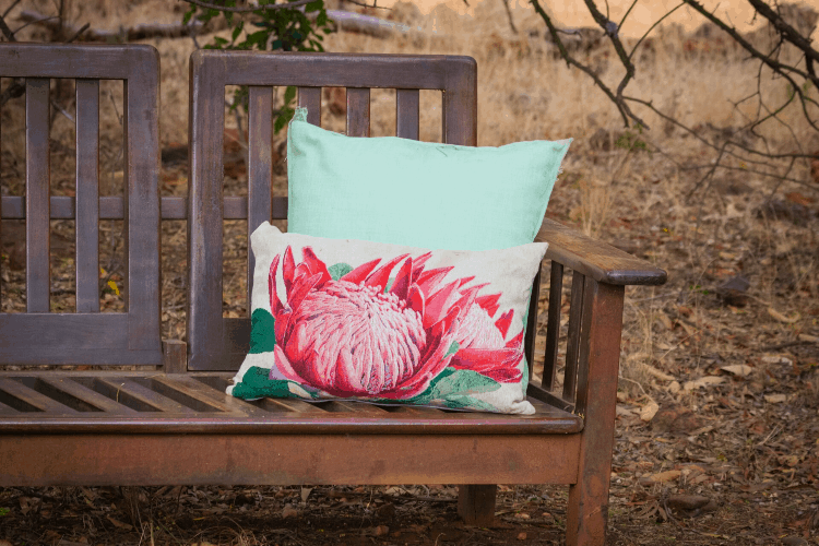 a pillow on a bench