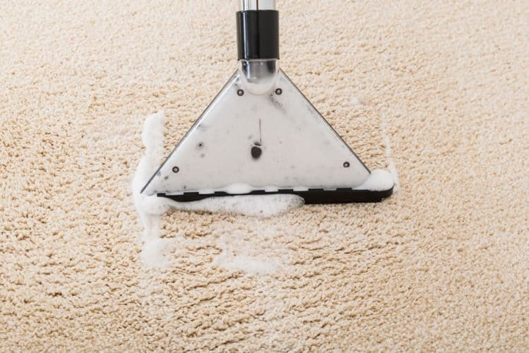 a vacuum cleaner over a carpet