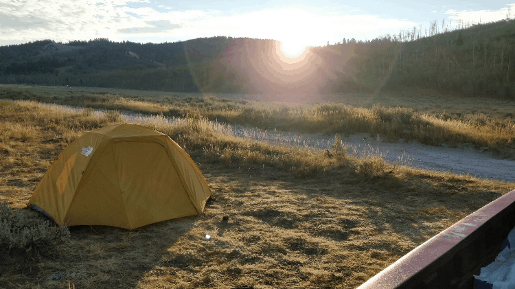 a yellow camping tent