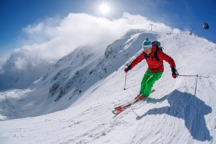man skier skiing in the mountains