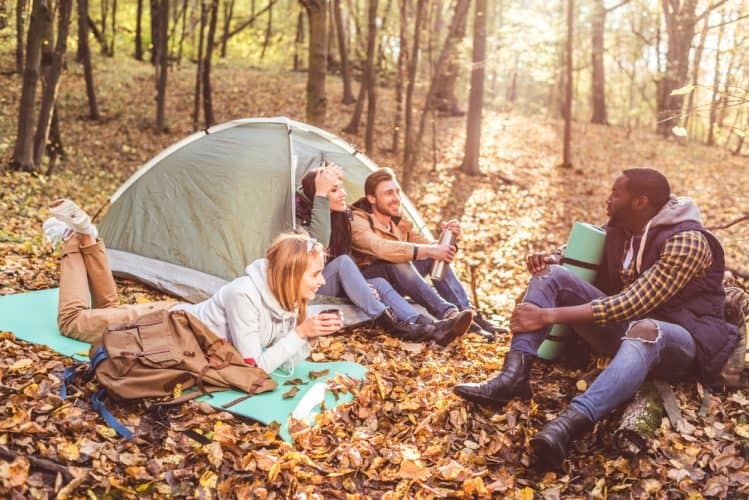 a group of friends camping in the woods