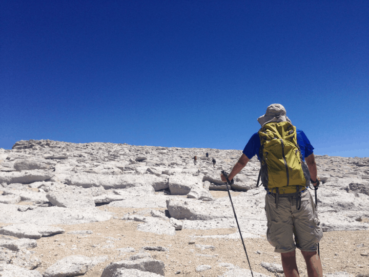a hiker with a yellow backpack