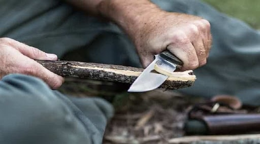 Building Camp with Knife